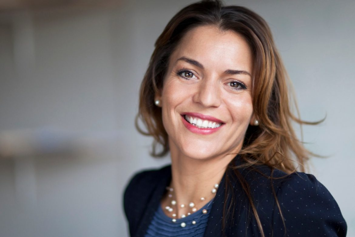 spanish-businesswoman-smiling-at-the-camera-at-the-office-picture-id626709294